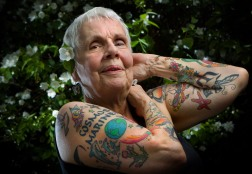 Senior citizen Helen Lambin shows off her tattoos while standing in the backyard of her Edgewater neighborhood home in Chicago, Wednesday, June 15, 2010. She feared growing old gracefully so she now wears tattoos, gaining her much attention on the street during summer months. (Alex Garcia / Chicago Tribune) B581342878Z.1 ....OUTSIDE TRIBUNE CO.- NO MAGS, NO SALES, NO INTERNET, NO TV, NEW YORK TIMES OUT, CHICAGO OUT, NO DIGITAL MANIPULATION...