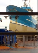 Ship being painted outside hotel window